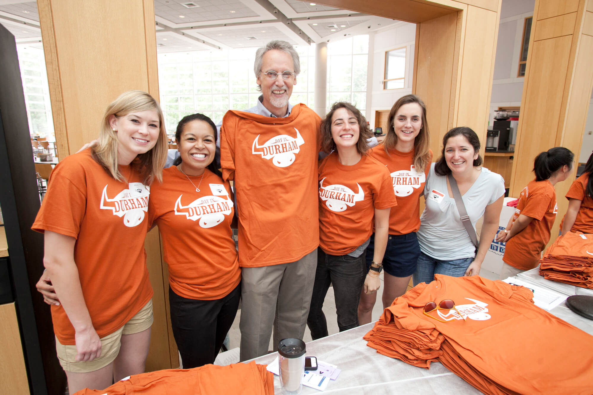 Bill Boulding with students wearing Durham t-shirts