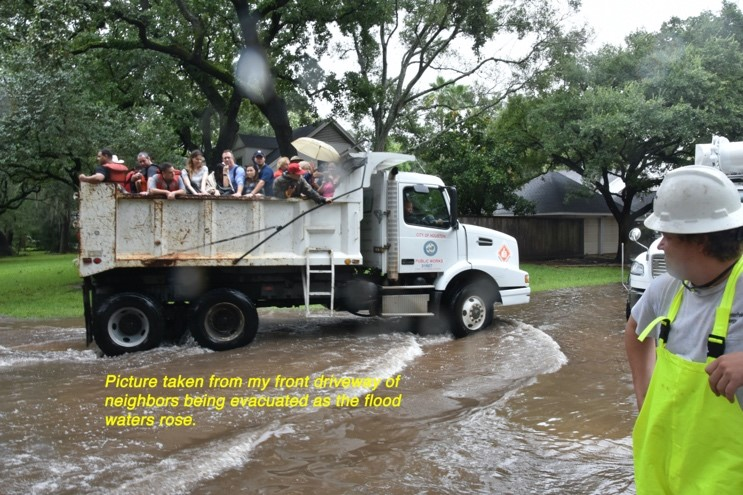 """Picture taken from my front driveway of neighbors being evacuated as the flood waters rose."""