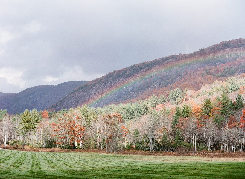 Rainbow against mountain backdrop