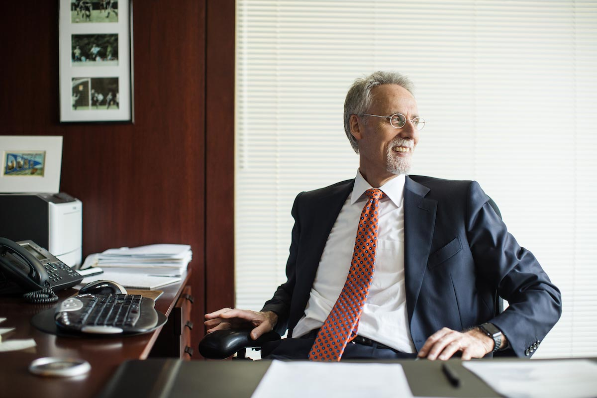 Dean Bill Boulding sitting in office