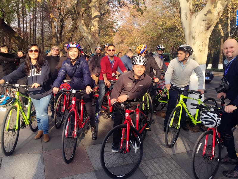 Fuqua Students on a bike tour of West Lake, a freshwater lake in Hangzhou